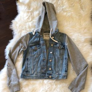 Denim jacket with grey fleece sleeves and hood